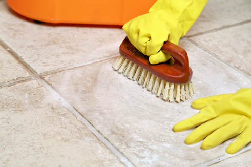 Hand cleaning floor with brush